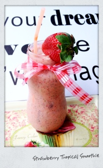 Strawberries are in season, try my Strawberry Tropical Smoothie!!